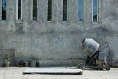 concrete mixer near cement wall