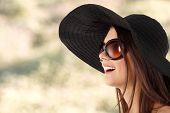 stock photo of panama hat  - summer teen girl cheerful in panama and  sunglasses over nature background - JPG