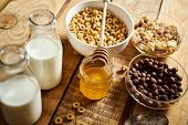 Healthy Morning Breakfast With Different Types Of Breakfast Cereals With Honey And Milk On Table poster