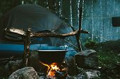 Food In Cauldron Is Heats Up On Bonfire, Surrounded By Stones Near Tent. Cooking In Open Air In Fore poster