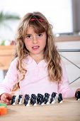 foto of reunited  - little girl playing with penguin figurines - JPG