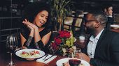 African American Couple Dating In Restaurant. Romantic Couple In Love Dating. Cutel Man And Girl In  poster