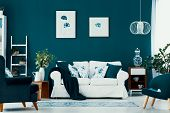 Floral Poster On Emerald Wall In Chic Living Room Interior With White, Blue And Wooden Furniture In poster