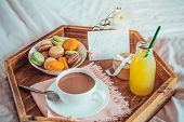 Breakfast In Bed With I Love You Text On A Note. Cup Of Coffee, Juice, Macaroons, Rose Flower And Gi poster