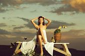 Pretty Girl In White Sexy Dress Denuded Gorgeous Body With Red Wine Glass Wicker Bottle And Vine On  poster