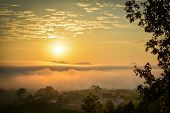 Winter Sunrise / Beautiful Morning With Fog Sunrise Over Misty On Meadow And In Village poster