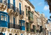 luxury mansions baroque style with the traditional balconies wooden in a Valletta street, Malta