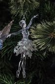 Transparent Ballet Dancer Ornament On A Christmas Tree. Christmas Decoration With A Transparent Ball poster