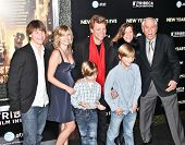 NEW YORK, NY - DECEMBER 07: Jon Bon Jovi with family and producer Garry Marshall  poses for a photo
