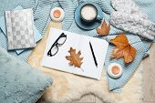 Flat Lay Composition With Book, Cup Of Coffee And Warm Blanket On Fuzzy Rug poster