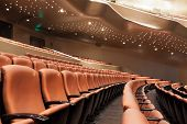 foto of cinema auditorium  - Rows of chairs in modern theatre interior - JPG