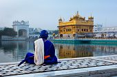 foto of gurudwara  - Unidentifiable Seekh Nihang warrior meditating at Sikh temple Harmandir Sahib - JPG
