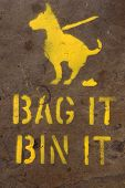 pic of dog-walker  - A sprayed on pavement sign asking dog walkers to bag and bin up their mess - JPG
