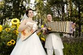 picture of accordion  - fiancee blow the balalaika bridegroom play on accordion wedding humour photo - JPG