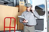 stock photo of movers  - Happy professional shipping courier - JPG