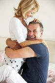 Senior Couple Relaxing Together In Bed