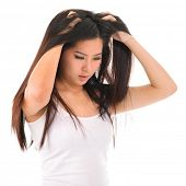 picture of dandruff  - Young Asian girl scratches her hair on white background - JPG