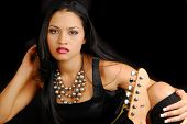picture of groupies  - Attractive hispanic female rocker with her guitar - JPG