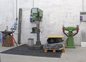 Workshop With Drill And A Millstone For The Manufacture Of Iron And Steel