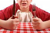 stock photo of table manners  - young male impatiently waiting for his dinner - JPG