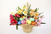 Easter Basket Of Flowers And Eggs.