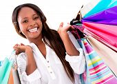 Beautiful shopping woman looking very happy - isolated over white