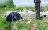image of corpses  - Crime scene with corpse and evidence outdoors - JPG