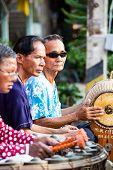 SUKHOTHAI, THAILAND - MAY 4: Unidentified blind musicians are playing Thai traditional music on May 4, 2013 at Rim Yom 2437 night market, Sukhothai, Thailand.