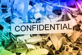 scraps of paper with the word confidential, symbolic photo for data destruction, bank secrecy and co
