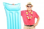 Mature man on vacation holding a swimming mattress, isolated on white background