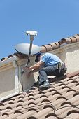 Satellite Installation Technician Wiring Dish to Home
