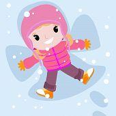 girl in snow making angel