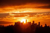 Sun rising over Los Angeles city skyline