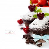 fresh chocolate muffins with cherry. With easy removable sample text
