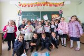 MOSCOW - SEP 1: Dressed first-graders with gifts in hands in a classroom of School No.1349 on Septem