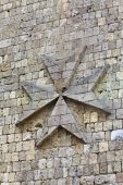 foto of maltese-cross  - Medieval wall detail image from a castle with the maltese cross on it - JPG