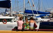 Young Women And Yachts In A Marina.