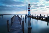 picture of pier a lake  - Ocean sea pier - lighthouse at a sunset