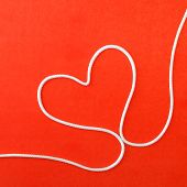 Heart Made From Rope On Red Background