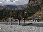 Destroyed bridge over Marsyangdi River, still in use