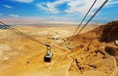 stock photo of masada  - Cable car in antique  fortress Masada in Israel - JPG