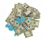 stock photo of lobbyist  - Photo of prescription drugs and pile of money - JPG