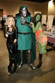 Paula Labaredas and Alicia Arden from CelebrityCosplay.com with Dr. Doom  at Long Beach Comic-Con Da