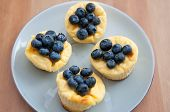 image of cheesecake  - Home made Lemon Cheesecake Muffins with blueberries - JPG
