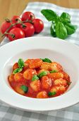 Home made italian gnocchi with tomato sauce and basil