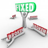 One person lifts the word Fixed while others are crushed Broken power solving problem