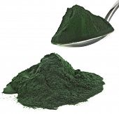 Spirulina powder algae nutritional supplement heap close up , isolated on white background