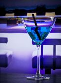 Blue Cocktail Drink On A Lounge Bar Table With Space For Text
