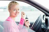 Woman driver showing car keys.