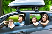 stock photo of car-window  - Happy family sitting in the car - JPG